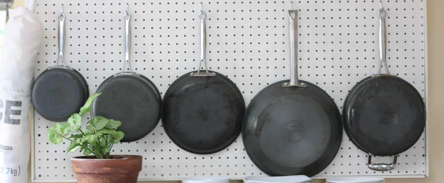 pans on pegboard