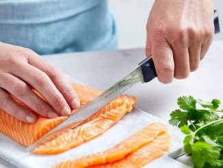 cutting fish with fillet knife