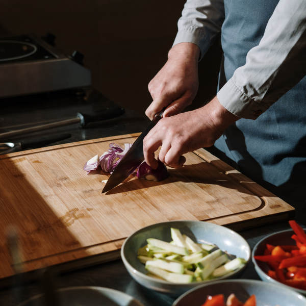 slicing vegetables with a kitchen knife