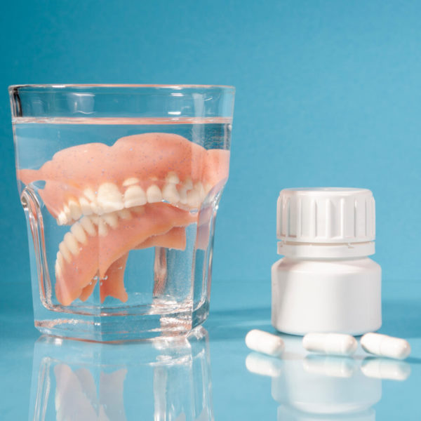 cleaning teeth with denture tablets