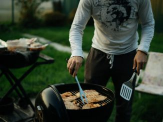 cooking on charcoal grill in backyard