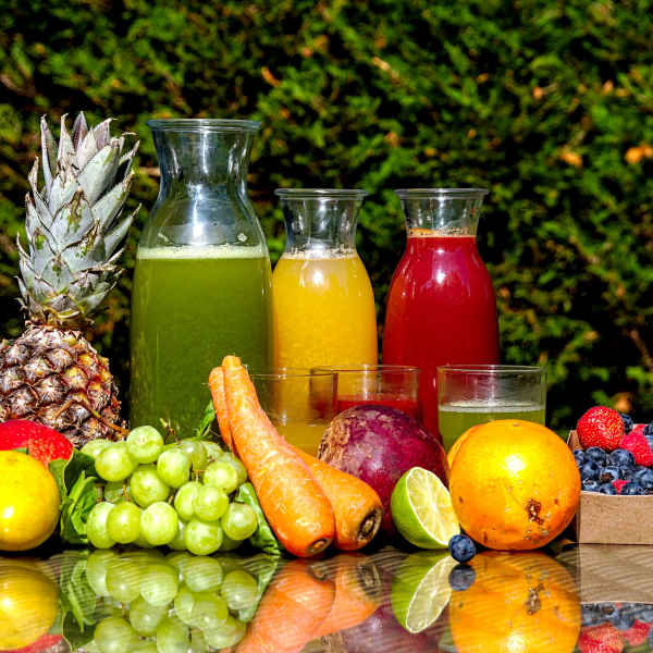 fruit, vegetables, and juice on table