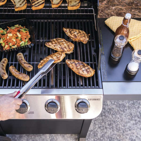flipping food on gas grill