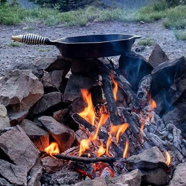 cast iron skillet over open fire