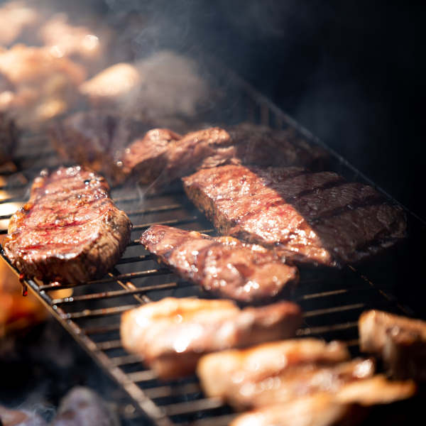 cooking meat on a grill