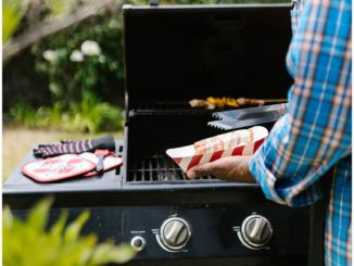 man cooking on 2-burner gas grill