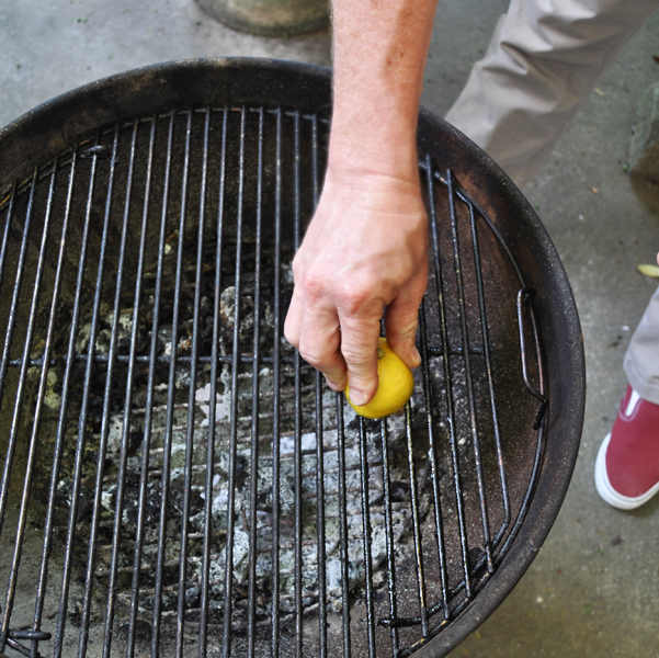 cleaning charcoal grill with lemon