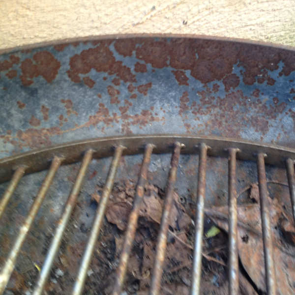 rusty charcoal grill