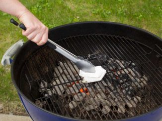 cleaning charcoal grill grate with towel