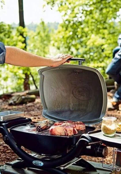 closing lid of portable gas grill
