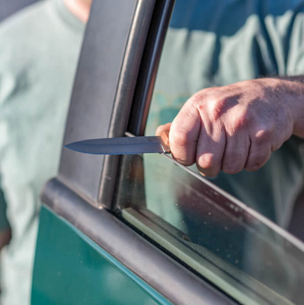 sharpening knife on car window