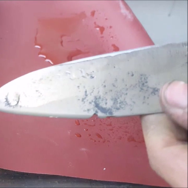 sharpening knife on sandpaper