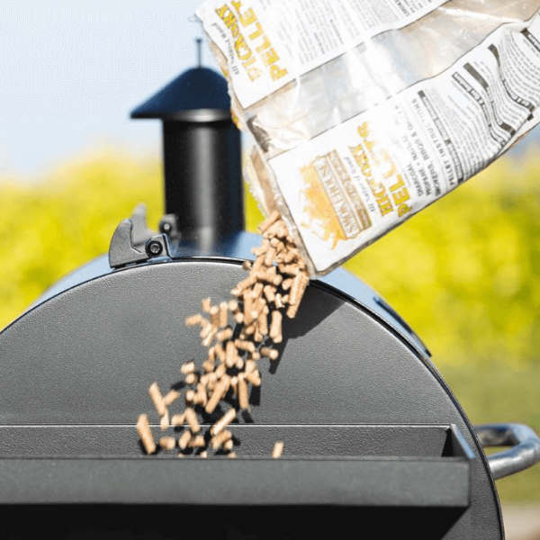 loading pellet grill with pellets