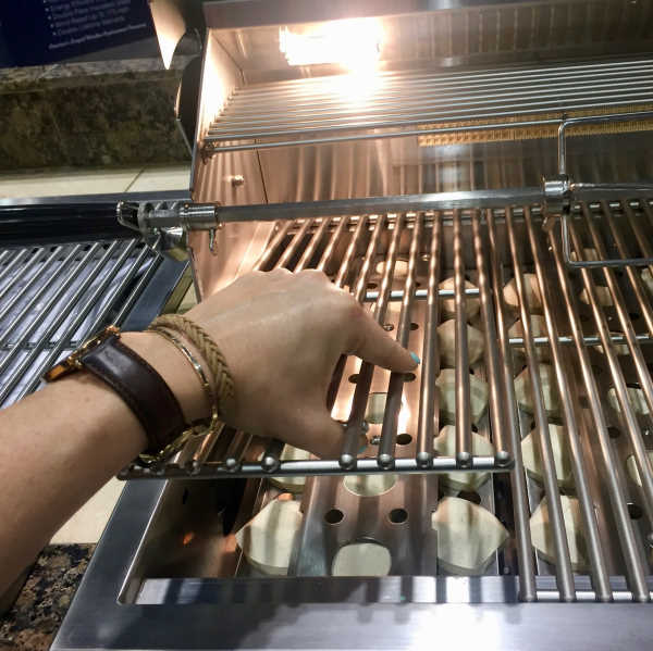 placing grates back on gas grill